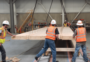 Catalyst CLT panels being assembled onto glulam beams in the Spokane Valley factory.
